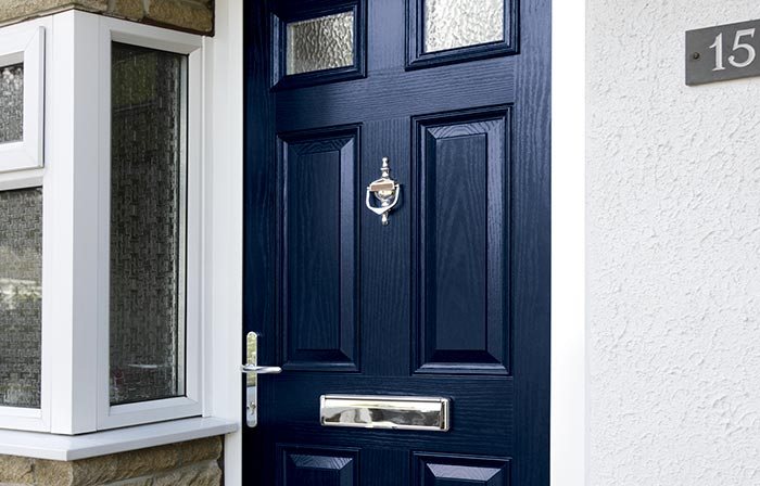 Blue entrance door in thick composite material